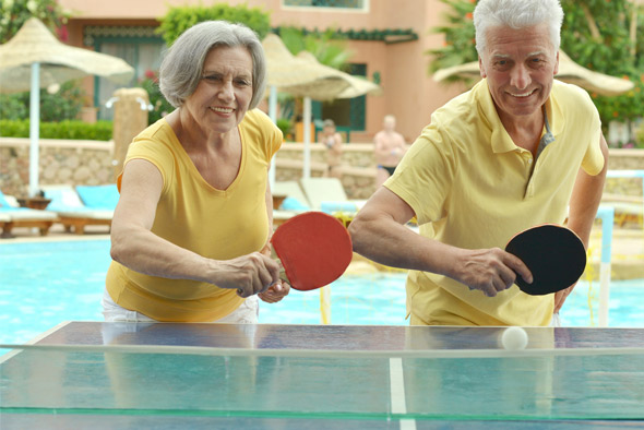 elderly-couple-playing-ping-pongjpg